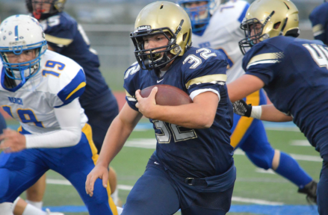 Canaan Fagerland (32) rushes against Beach defense