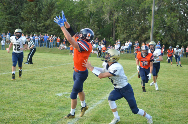 Junior receiver Ty Snyder goes up for a catch against Shiloh defense. Photo courtesy of Tim Mitzel
